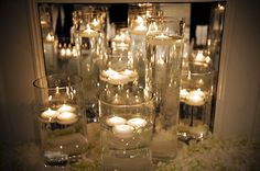 floating candles in different size/shape vases