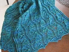 A graceful lace pattern inspired by the calm and beauty of the sea. It is designed to be knit in 2 halves, from cast-on edge to center.