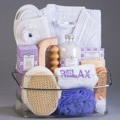 """This luxurious lavendar spa, set in a reusable caddy hold will leave an indelible mark of relaxation upon the recipient. Allow someone you love to enter a new day with rejuvenated body and spirits. We`ve included a ruffled waffle cotton bathrobe and slippers, and embroidered """"relax"""" fluffy towel, along with silky body cream, lavedar bath salts, and lavendar perfumed soap, and an assortment of wooden scrubs and massager."""