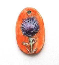 Thistle Pendant Orange and Purple by Mary Harding.