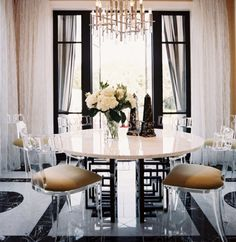 klismos style lucite chairs, black windows, black and white floors - breakfast area.