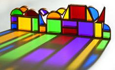 Colourful wooden blocks create wonderful shadows.