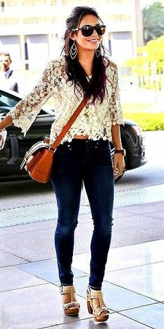 Gorgeous blue casual stylish jeans and top white stylish lace and brown leather hand bag and light pink stylish high heels ladies sandals