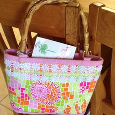 NWT Lily Pulitzer purse NWT Lily Pulitzer purse with bamboo handles. Zipper compartment inside. Lilly Pulitzer Bags