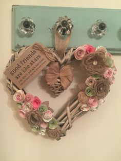 Brown double heart wicker wreath with handmade hessian and paper flowers in brown, pink, green and orange with 'friends' tag. Good Friends Are Like Stars, Wicker Hearts, Hessian, Wall Decorations, Green And Orange, Paper Flowers, Elsa, Projects To Try, Wreaths