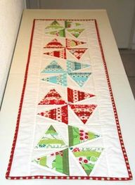 Christmas table runner using Tri Rec Tools http://quiltingimage.com/christmas-table-runn-2/