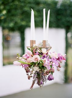 hanging floral arrangement - photo by Emily Katharine Photography http://ruffledblog.com/lavender-and-copper-wedding-inspiration