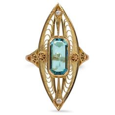 This yellow gold Victorian ring features a radiant shaped aquamarine and two cultured seed pearls in a marquise-shaped frame. Spectacular milgrained latticework and intricate designs complete this stunning piece (Aquamarine approx. Victorian Jewelry, Antique Jewelry, Vintage Jewelry, Victorian Ring, Handmade Jewelry, I Love Jewelry, Fine Jewelry, Jewelry Design, Pearl Jewelry