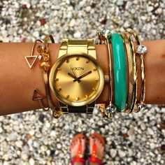 """Glitz and gold.. All a girl could need!!  Score the @nixon_now """"cannon gold"""" ($150), bracelets ($8.99-$14.99) and """"tri color t strap sandals"""" ($19.99) shop in store at #4thandocean and statements! Call 844.232.7364 ext 3/5 to order NOW!  #sophieandtrey #freeshipping #shop #fashion #trend #ootd #armparty #nixon #watch"""