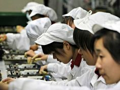 Staffs works on the production line at the Foxconn complex in the southern Chinese city of Shenzhen, Southern city in China, Wednesday, May 26, 2010. The head of the giant electronics company whose main facility in China has been battered by a string of worker suicides opened the plant's gates to scores of reporters Wednesday, hours after saying that intense media attention could make the situation worse.  (AP Photo/Kin Cheung)