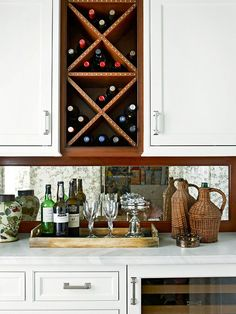 Mercury glass mirror over cabinet, Bruce's should have shelving above but this is the idea