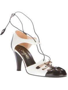 Chanel shoes from A.N.G.E.L.O. VINTAGE PALACE Black and white patent leather shoes from Chanel featuring a round toe, a lace-up front fastening with logo details and a mid high heel.