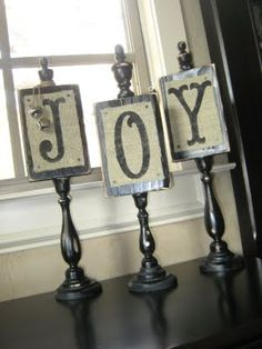 Whitney's Christmas JOY Plaques -Glue plaque to candlestick, glue finial on top, then chalkboard paint (J-O-Y for Christmas, B-O-O for Halloween, Monogram initials, etc., etc.)