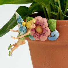Jim Shore Tinkerbell Pot Sitter from the Disney Traditions collection.  http://www.thecollectorshub.com/homedecor.html