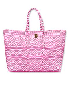 Joie's woven zig-zag carryall in fuchsia is sure to pop whether you're beach or poolside ($118 at joie.com).