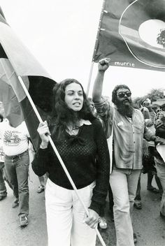 Marcia Langton (foreground) and Bob Weatherall (right) marching with protesters. Professor Marcia Langton was instrumental in the marches of the 1982 Commonwealth games and played an important role in the day-to-day organisation of community and actions from Musgrave Park. Uncle Bob is a Gumulray elder who worked for many years at the Foundation for Aboriginal and Islander Research Action (FAIRA). Image courtesy of Bob Weatherall.