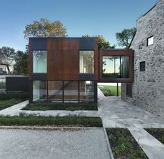Intergenerational Historic Stone Home Gets Steel Extension