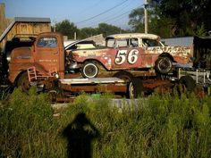 A 50's Chevy loaded on a flat bed and left behind.