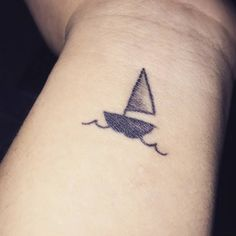 Small wrist tattoo of a sailboat. - Small Tattoos for Men and Women
