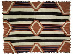 This Navajo wearing blanket from the 19th century is in a third-phase pattern with its nine diamonds and half-diamonds.