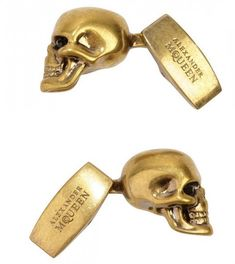 Alexander McQueen cufflinks. Maybe one day, when I'm wealthy enough that I can afford to drink Voss.