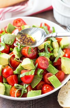A light and refreshing salad with tomatoes, avocado, basil with a simple homemade balsamic vinaigrette. Tomato Basil Salad, Cherry Tomato Salad, Tomato Mozzarella, Salad Recipes Healthy Vegetarian, Healthy Fruits, Whole30 Recipes, Basil Recipes, Avocado Recipes, Vinaigrette