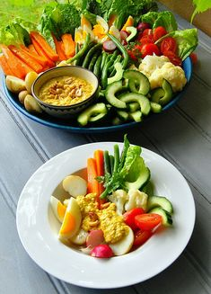 Gado-Gado: a hot & cold #salad with a spicy peanut sauce. This is a most unusual recipe, combining raw and  cooked ingredients, and a great choice for a big gathering!