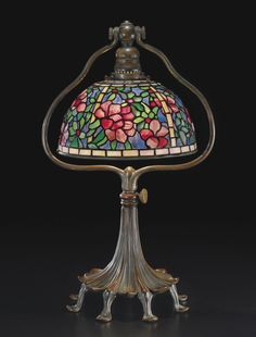 "** Tiffany Studios New York ""Azalea"" leaded glass and patinated bronze table lamp."