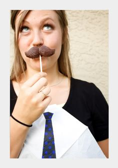 Mustache chocolate lollipops and necktie napkins are perfect for meal-time fun and photo-booth accessories.