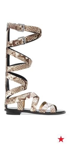 These fab snakeskin gladiator sandals from Michael Michael Kors take the glam to new heights. Rock them with a cropped vintage tee and distressed shorts for a Spring style statement that just screams cool