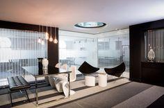 contemporary office design. neutral palette. black white grey interiors. break out space. manifestation design