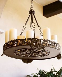 Outdoor Chandelier $415.00  I am thinking an ornate tray and chain all painted bronze and add candles.  This would be very inexpensive for DIY!