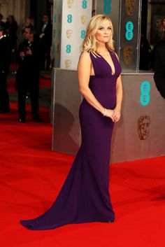Reese Witherspoon had a fashionable red carpet moment at the 2015 Baftas in a stunning, low-cut purple gown.