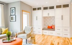 built-in cabinets / oil-rubbed bronze hardware / gray walls / Transitional Family Room by Design Harmony