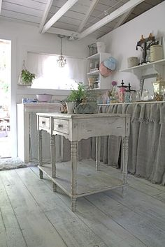 ~ cupboards with skirts  (photo from Chez Fifi)