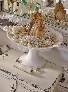 ❥ pearls surround a vintage wedding cake topper~ display at a trunk show