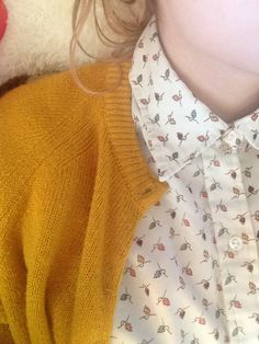 mustard cardigan on print shirt.