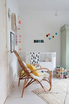 colorful lttle nursery, love the mid-century modern chair. #estella #kids #decor