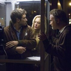 Director David Fincher with Jake Gyllenhaal and Chloë Sevigny behind the scenes of Zodiac (2007).