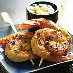 Tandori Shrimp Skewers with Pineapple Chutney, like the presentation of two shrimp curled around each other