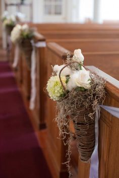 SOUTHERN FLAIR: Dainty hydrangeas and roses were bedded in cotton and Spanish moss to add a Lowcountry touch to standard aisle liners.