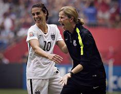 USWNT head coach Jill Ellis and midfielder Carli Lloyd celebrate after winning