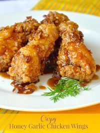 Crispy Honey Garlic Chicken Wings - Crispy fried wings get tossed in a very easy to make honey garlic sauce just before serving. This method ensures the wings stay super crispy in the sweet sticky, finger licking good glaze. Another sure fire hit for a Superbowl party or any time.