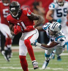 PanthersFalconsFootball Atlanta Falconswide receiver Julio Jones(11) runspast Carolina PantherscornerbackDaryl Worley(26) during the second half of an NFL football game, Sunday, Oct. 2, 2016, in Atlanta. (AP Photo/John Bazemore)