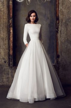 View Modest Ball Gown Wedding Dress - Style from Mikaella Bridal. Crêpe bodice with bateau neck and sleeves. Full Organza skirt with pockets. Wedding Dress Chiffon, Classic Wedding Dress, Princess Wedding Dresses, Modest Wedding Dresses, Wedding Dress Styles, Timeless Wedding Dresses, Simple Wedding Dress Sleeves, Wedding Dress Pockets, Sleeve Wedding Dresses