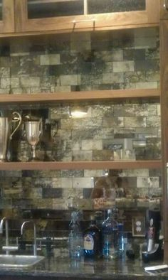 My handmade distressed mirror subway tiles in a home's bar. Giovannetti Decorative Studio Lubbock Texas