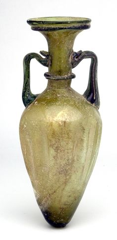 "A Marvellous Twin-handled Amphora. Roman Syria or Phoenicia, c. 3rd to 4th century AD. Height: 8-3/8"". Blown from a yellow-green to faintly olive glass $2,530"