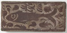 Ceiling Tile with Fish Date: late 1400s to mid-1500s Geography: Made in Benaguacil, Valencia, Spanish Culture: Spanish Medium: Earthenware with slip decoration and paint