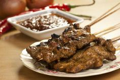 An easy party appetizer that brings the heat: beef satay with spicy Szechuan sauce. #recipe