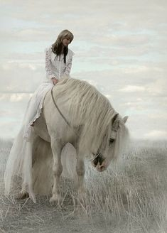 Pretty white horse walking through the tall grass. Gorgeous long white mane, with grey and pink nose being ridden by girl in long white dress. Such a pretty pic. Great horse photography. Soft beautiful clouds in the background make this look like a memory. Please also visit www.JustForYouPropheticArt.com for more colorful art you might like to pin. Thanks for looking!